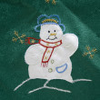 Table cover with snowman — Stock Photo