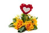 Rose flower arrangement with heart — Stock Photo