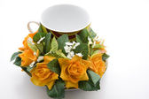 Coffee cup with roses — Stock Photo