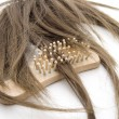 Hairpiece with hairbrush — Stock Photo