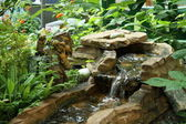 Stone wells with watercourse — Stock Photo
