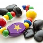 brinquedos do bebê com pedras — Foto Stock