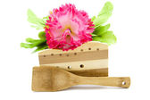 Wooden scraper with flower — Stock Photo