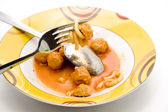 Minced meat flesh small ball in sauce — Stock Photo