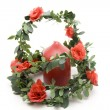 Rose garland with candle — Stock Photo