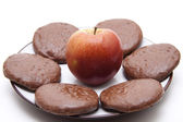 Red apple with cookie — Stock Photo