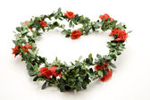 Rose garland with leaves — Stock Photo