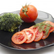 Tomato with broccoli — Stock Photo