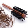 Hairbrush with hair locks   — Stock Photo