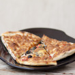 Fresh pizza on plate — Stock Photo