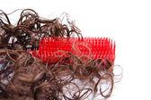 Röd hårborste med hår lås — Stockfoto