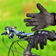 Mountain biker wears old gloves — Stock Photo #19147649