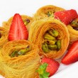 Royalty-Free Stock Photo: Baklava with pistachio nuts and strawberry