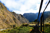 Peruvian train and ancient buildings — Stock fotografie