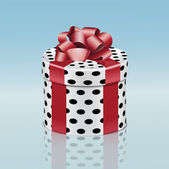 Round gift box with red ribbon — Stockvector