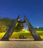 Memorial monument with bell in park near Donbass Arena Stadium i — Stock Photo