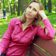 Woman resting sitting on park bench — Foto Stock