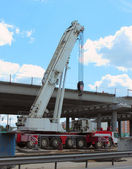 Mobile crane on the construction of the motorway — Stock Photo