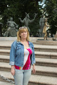 A woman is standing on a monument to human vices — Stock Photo