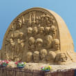 A sand sculpture of The clock of history — Stock Photo