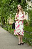 A woman in a bright dress — Stock Photo