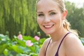Beautiful woman in the lotus park — Stock Photo