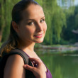 Portrait of young beautiful woman traveler in nature on sunset - Stock fotografie