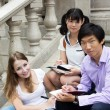 Royalty-Free Stock Photo: Students study outside of school campus. Friends working togethe