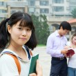 Young girl holding book. Asian female student with book — Stock Photo