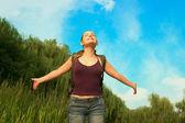 Young beautiful woman enjoying life. Freedom concept of happines — Stock Photo
