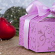 Decorated Christmas gift box with red heart - Zdjęcie stockowe