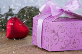 Decorated Christmas gift box with red heart — Stock Photo