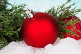 New year ball decoration with branch of Christmas tree — Stock Photo