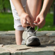 Stock Photo: Running shoes being tied by woman. Fitness jog wellness concept