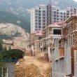 Construction of building of new houses, still under construction - Stock Photo