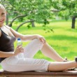 Young happy smiling sport fitness woman outside on summer - Stock Photo