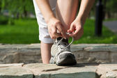 Running shoes being tied by woman. Fitness jog wellness concept — Stock Photo