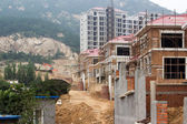 Construction of building of new houses, still under construction — Stock Photo