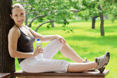 Young happy smiling sport fitness woman outside on summer — Stock Photo