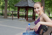 Woman resting in park after exercise. Sport fitness concept — Stock Photo