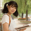 Young Asian girl studying hard in the park — Stock Photo