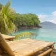 Bamboo chair on a beach - Foto Stock