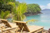 Bamboo chair on a beach — Stock Photo