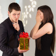 Man holds gift box for woman — Stock Photo #35195041