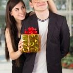 Happy romantic couple with gift — Stock Photo