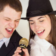 Man and woman singing at microphone — Stock Photo
