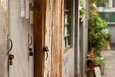 Closeup old wood door with lock in grungy style — Stok fotoğraf