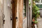 Closeup old wood door with lock in grungy style — Foto de Stock