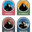 Four seasons mountain icons — Stock Vector
