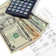 Stock Photo: Money and calculator